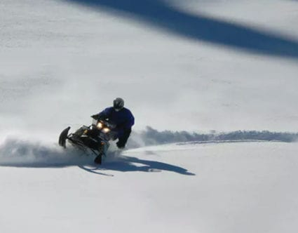 Riding-Snowmobile-backcountry